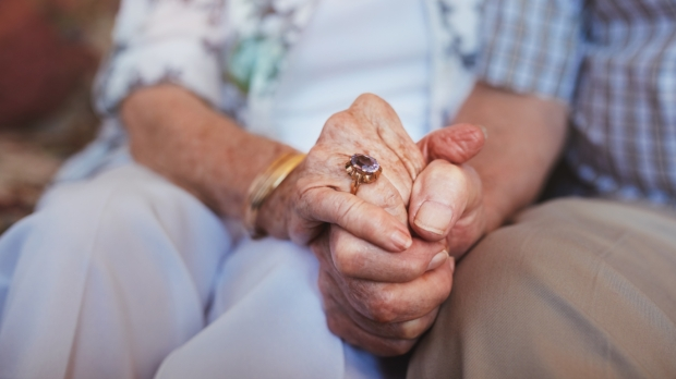OLD COUPLE HAND IN HAND