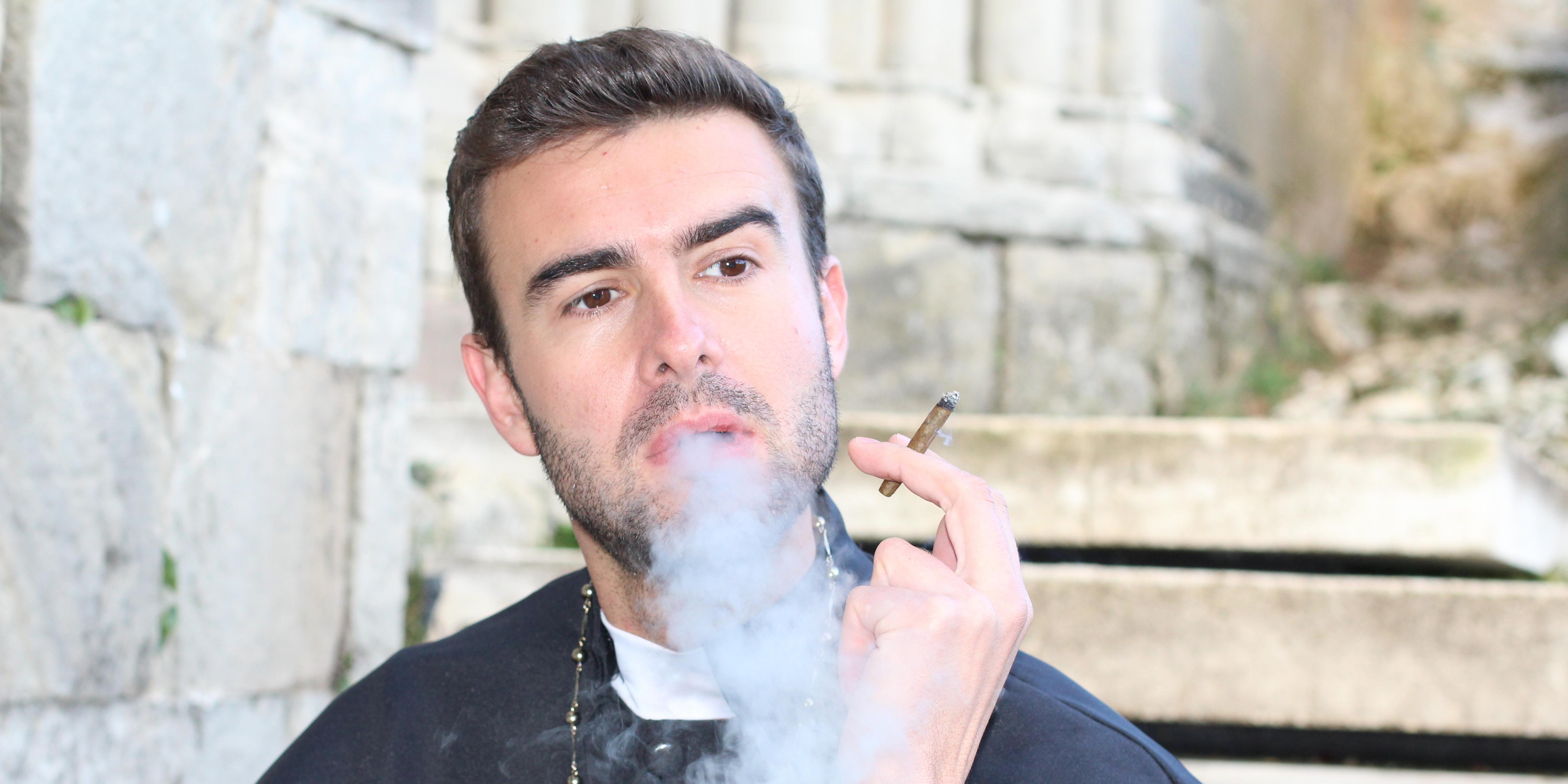 PRIEST SMOKING