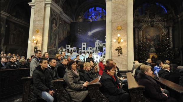 People at mass on christmas eve