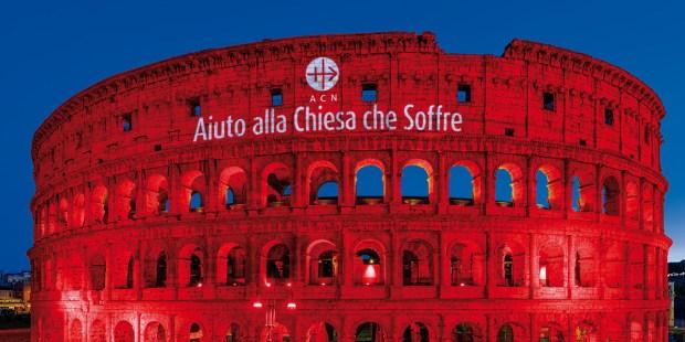 red colosseum Aiuto alla Chiesa Che Soffre
