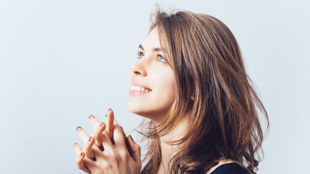 WOMAN PRAYNG SMILING