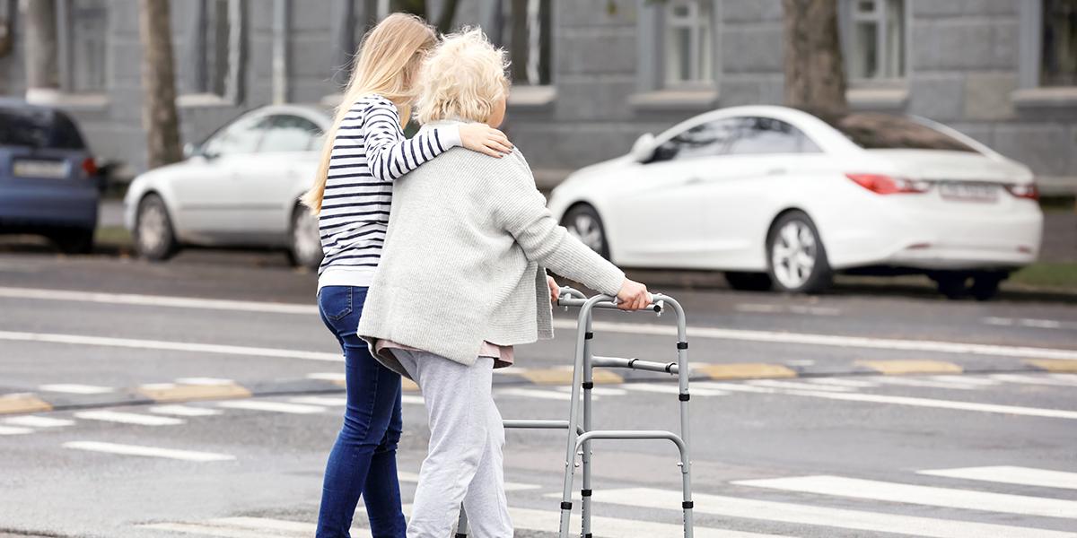 WOMAN HELPING ELDERLY