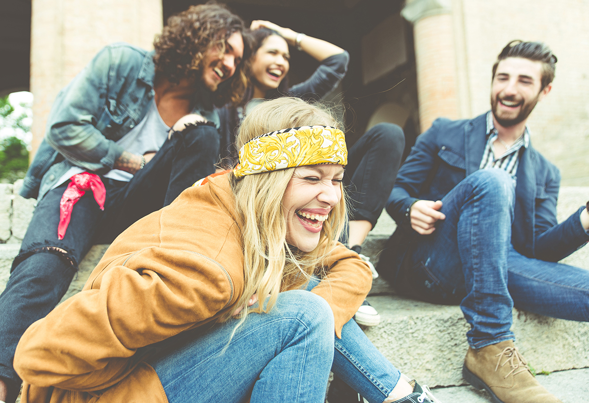 GROUP OF FOUR FRIENDS LAUGHING
