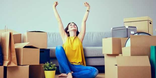 HAPPY YOUNG WOMAN MOVING