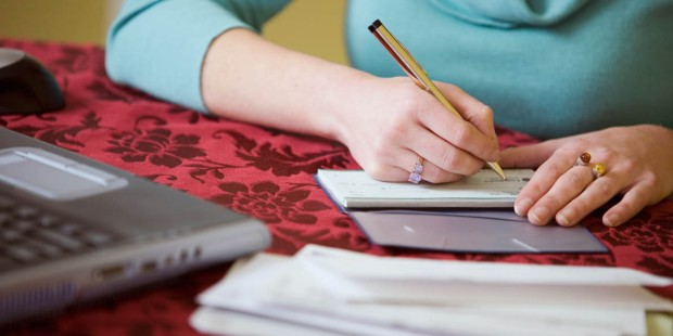 WOMAN,WRITING A CHECK