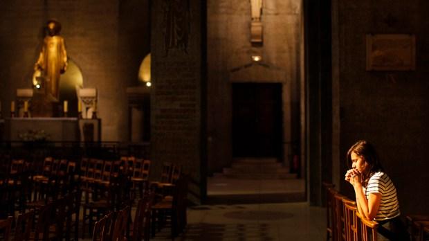 GIRL PRAYING IN CHURCH