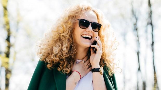 WOMAN TALKING ON PHONE