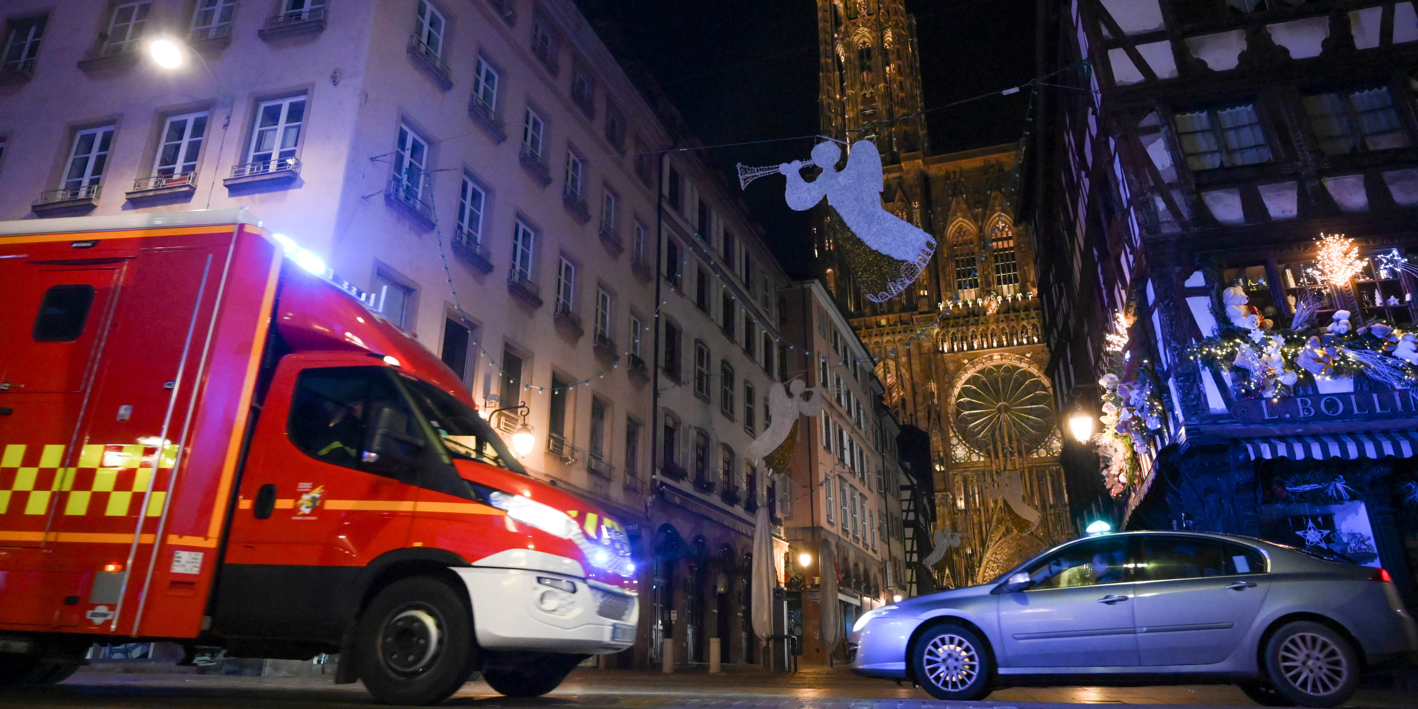 STRASBOURG ATTACKAn emergency medical response vehicle passes by the cathedral in Strasbourg, after a shooting breakout, on December 11, 2018. - A gunman killed at least three people and seriously injured another 11 near the famed Christmas market in the French city of Strasbourg before fleeing the scene, security officials said. Police launched a manhunt after the killer opened fire at around 7pm local time (1800 GMT), sending crowds of evening shoppers fleeing for safety. (Photo by SEBASTIEN BOZON / AFP)