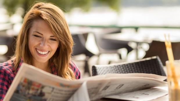WOMAN NEWSPAPER