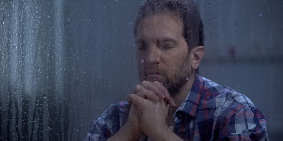 adult man praying