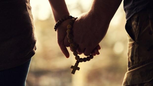 Couple Praying Rosary