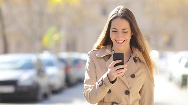 WEB2-WOMAN-STREET-PHONE-shutterstock_246869608.jpg