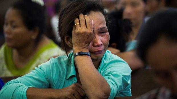 WEB2-PRAY-CRY-WOMAN-MYANMAR-AFP-000_14R2AN.jpg