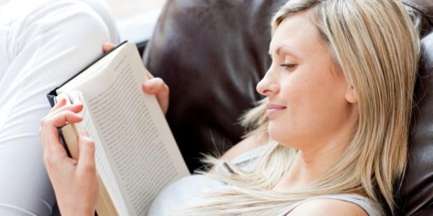 WOMAN READING,
